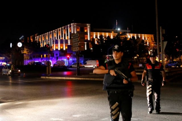 Police officers stand guard near the Turkish military headquarters in Ankara, Turkey, July 15, 2016. REUTERS/Tumay Berkin TPX IMAGES OF THE DAY
