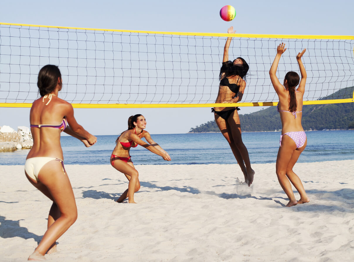 Group of people playing beach volleyball